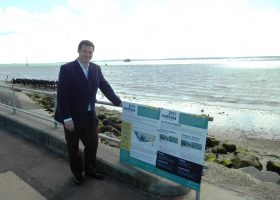Cllr Ashmore with seafront signs